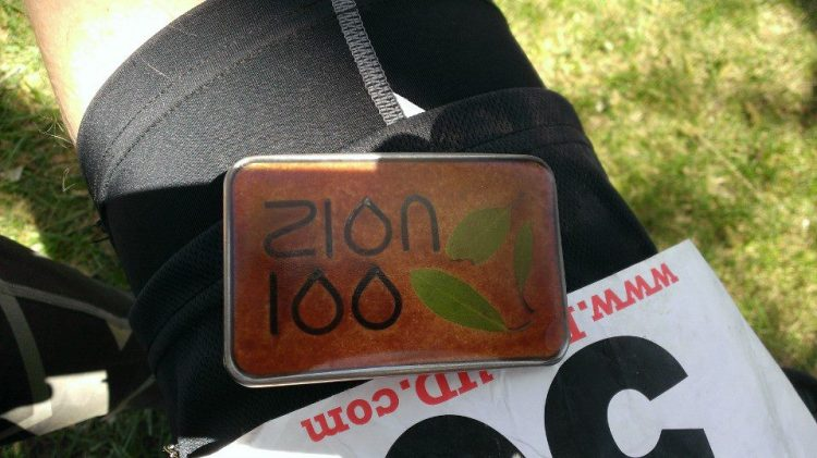 Photo of my Zion 100 finisher buckle that I took at the finish. A belt buckle is the typical reward for a 100 mile race.